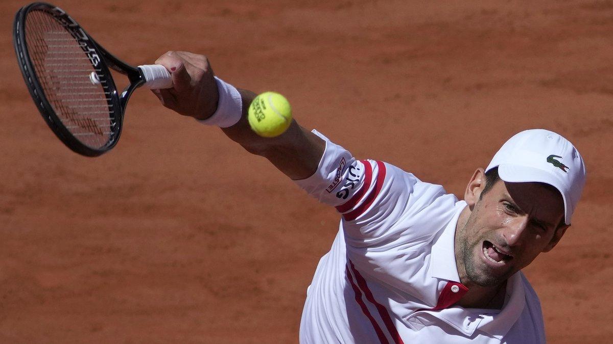 Serbia's Novak Djokovic serves to Stefanos Tsitsipas of Greece during their final match of the...
