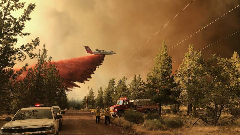This photo provided by the Oregon Department of Forestry shows a firefighting tanker making a...