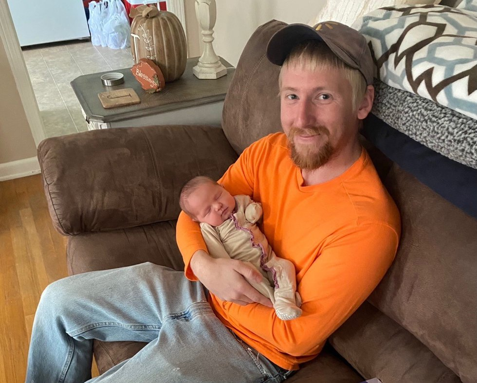 Michael Lee Dobbins, known as Lee, pictured with his daughter