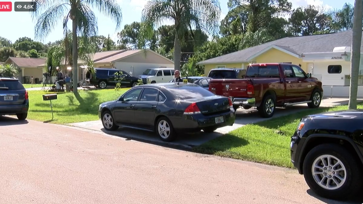 Police surround the home of the parents of Brian Laundrie Monday morning.