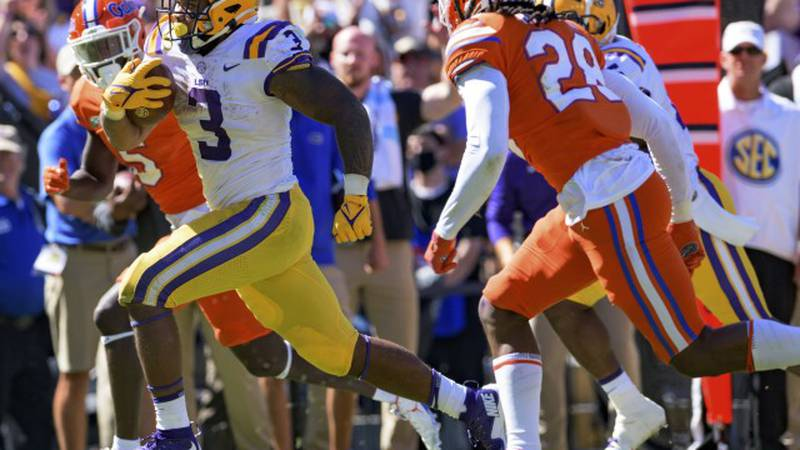 LSU running back Tyrion Davis-Price (3) scores a touchdown against Florida in the second half...