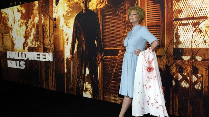 """Jamie Lee Curtis, the star and executive producer of """"Halloween Kills,"""" poses at the premiere..."""