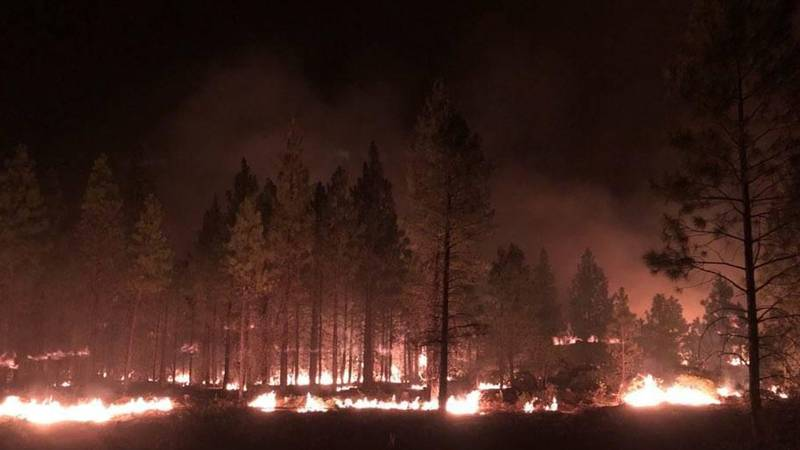 In this photo provided by the Bootleg Fire Incident Command, the Bootleg Fire burns at night...