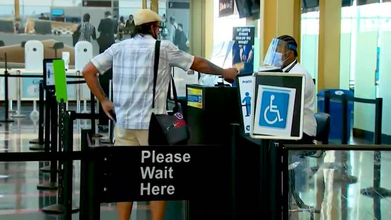 As COVID-19 hospitalizations surge, officials urge caution for Labor Day travel.