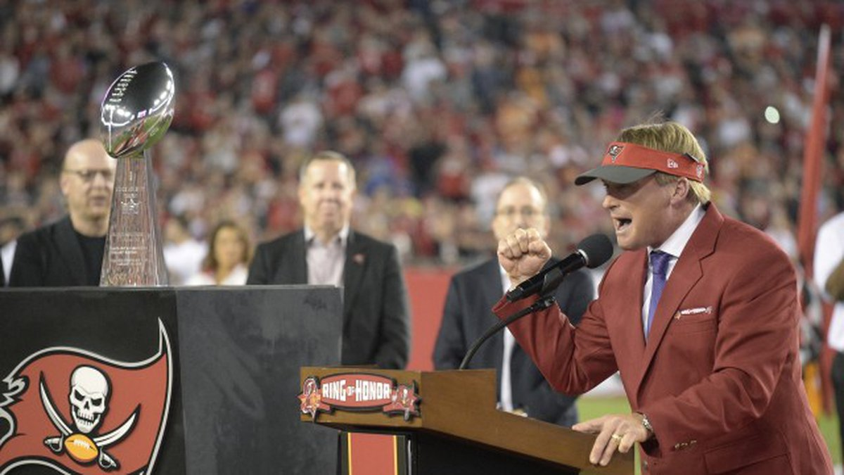 Former Tampa Bay Buccaneers head coach Jon Gruden addresses fans as he is inducted into the...