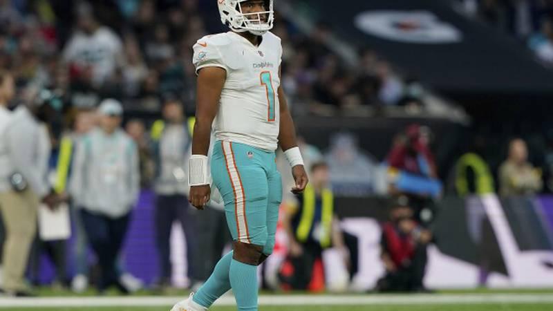 Miami Dolphins quarterback Tua Tagovailoa (1) walks out onto the field during an NFL football...