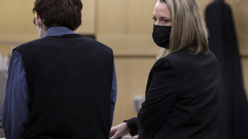Defense attorney Melisa McNeill is shown with her client, Marjory Stoneman Douglas High School...